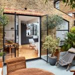 Interiors of refurbished south london appartment, exterior courtyard space